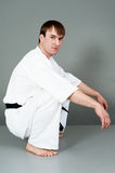 Young man. A young sportsman on karate sits in a studio Stock Images