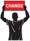 Young man. Holding a banner - change, protestant who wants to change Royalty Free Stock Image