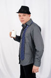 Young man. Man in a hat and untied tie gets on the hip glass Stock Photos
