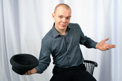Young man. Holds a hat in a hand Royalty Free Stock Images