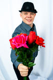 Young man. Holds flowers in a hand Stock Images
