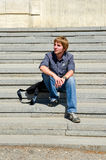Young man. Young student waiting in the sun Royalty Free Stock Images