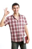Young man. Casual man smiling doing the ok sign over a white background Royalty Free Stock Photography