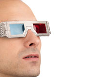 Young man in 3D glasses. Young man watching television in 3D glasses royalty free stock photography