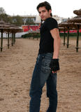 Young Man. A young man at the beach holding a gun Stock Images