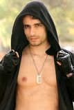 Young Man. A young attractive man showing his chest Stock Photography