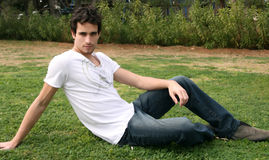 Young Man. Lying on the grass relaxing Royalty Free Stock Images