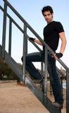 Young Man. Climbing a wooden staircase at the beach Royalty Free Stock Photos