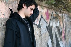 Young Man. In gothic look lying on a wall Stock Photos