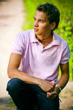 Young man. In pink shirt Stock Photo