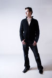 Young man. A young male model on a plain background wearing a sweater and jeans Royalty Free Stock Photography