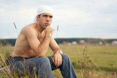 Young man. Thoughtful young man on nature Stock Photography