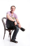 Young Man. Sitting on a bent-wood chair royalty free stock images