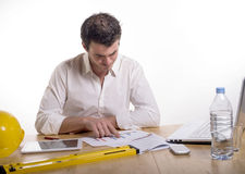 Young man absorbed in work Stock Images