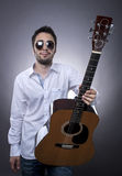 Young man with acoustic guitar Stock Images
