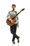 Young Man With Acoustic Guitar Royalty Free Stock Images