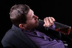 Young man addicted to alcohol Royalty Free Stock Photography