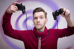 Young man addicted to video games Stock Images