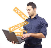 Young man adding friends on social network Stock Image