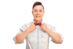 Young man adjusting his bow-tie Stock Photo