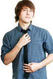 Young man adjusting his tie Stock Photography
