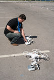 Young man adjusts copter aircraft Royalty Free Stock Photography