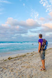 Young man admires view of Caribbean Sea Stock Images