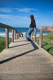 Young man admiring view on colorful scenic amazing atlantic ocean with breaking waves royalty free stock images