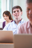Young Man In Adult Education Class Stock Photo