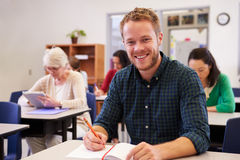 Young man at an adult education class looking to camera Royalty Free Stock Photos