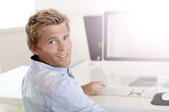 Young man in advertising apprenticeship Stock Image