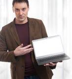 Young man advertising laptop Royalty Free Stock Image