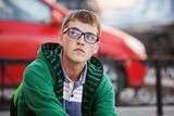 Teen boy in eyeglasses on a city street  Royalty Free Stock Photos