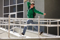 Young man against a university building Stock Photo