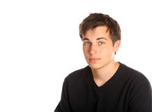 Young man against white background. Portrait of teenage boy on white background Royalty Free Stock Photography