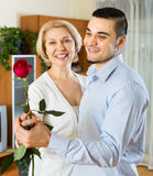Young man and aged woman dancing indoor Royalty Free Stock Photo