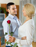 Young man and aged woman dancing indoor Stock Photos