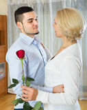 Young man and aged woman dancing indoor Royalty Free Stock Photos