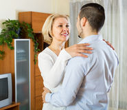 Young man and aged woman dancing indoor Stock Photo