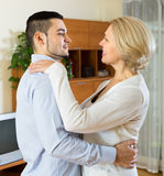 Young man and aged woman dancing indoor Royalty Free Stock Images