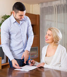 Young man and aged woman with documents Royalty Free Stock Photos