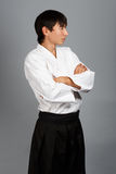 Young man in aikido uniform in serious pose Royalty Free Stock Photo