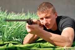 Young man aiming. With a hunter gun Royalty Free Stock Image