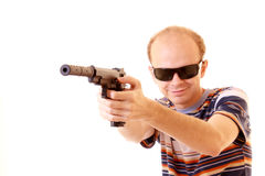 Young man aiming with gun Royalty Free Stock Photos