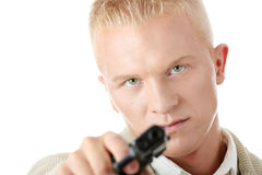 Young man aiming with pistol in hand. Young caucasian blond man aiming with pistol in hand Stock Photography