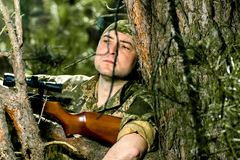 Young man with an air rifle Stock Photography