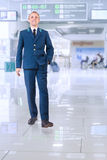 Young man in aircraft service uniform in airport area Royalty Free Stock Photo