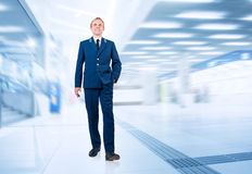 Young man in aircraft service uniform in airport area Stock Photography
