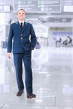 Young man in aircraft service uniform in airport area Royalty Free Stock Image