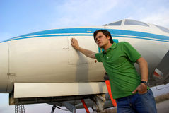 Young man beside airplane Royalty Free Stock Image